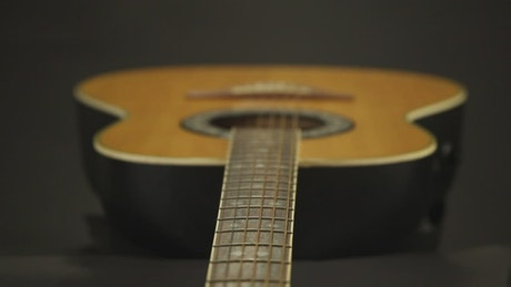 Camera zoom over an acoustic guitar