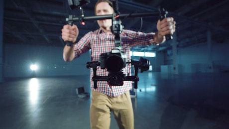 Cameraman walking with a camera stabilizer
