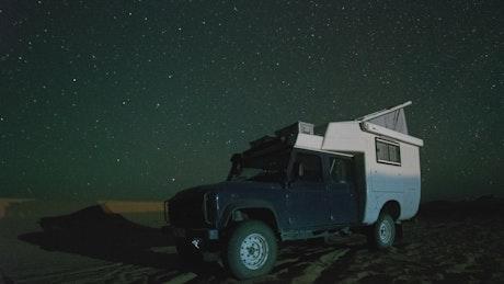 Camper van in the Sahara desert at night