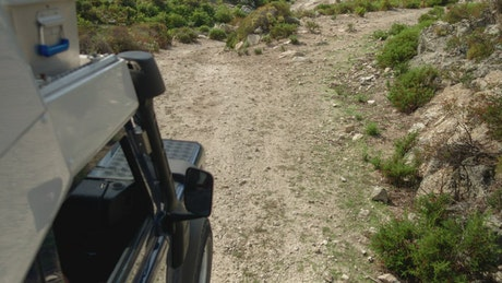 Campervan driving on rough tracks