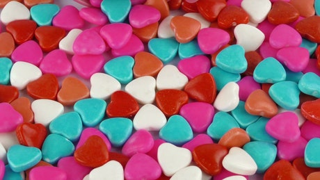 Candies and heart-shaped gums
