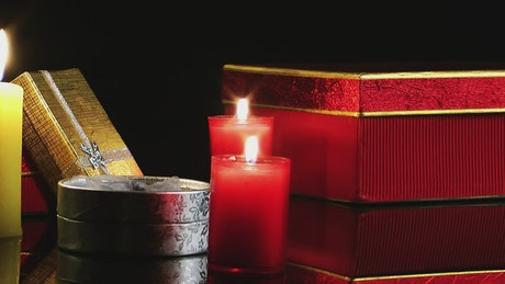 Candles and gifts on a dark background
