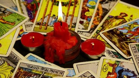 Candles burning between Tarot Cards