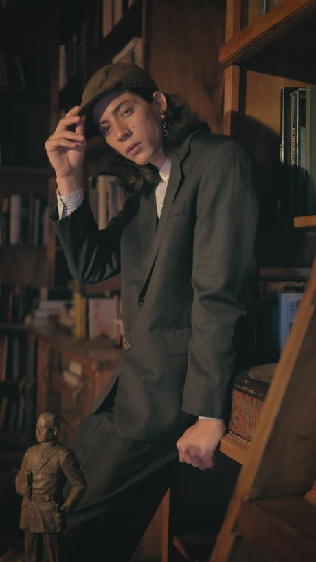 Captivating model with old fashion style in a bookstore