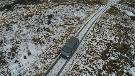 Car driving along a frozen path