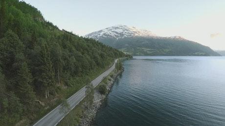 Car driving by a lake