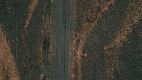 Car driving down a dirt road