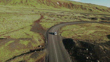 Car driving down a winding road
