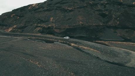 Car driving through mountain roads