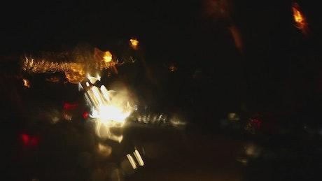 Car lights in the rain
