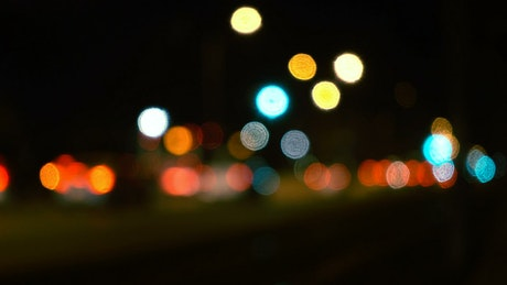 Car lights in traffic bokeh at night