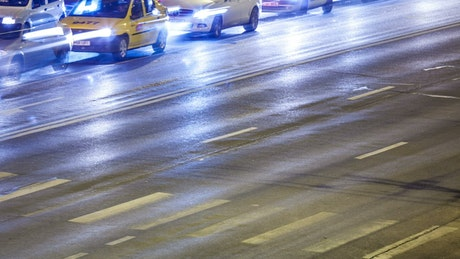 Car lights in traffic on an avenue
