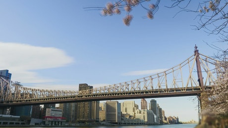 Cargo boat heading below a Bridge in NYC