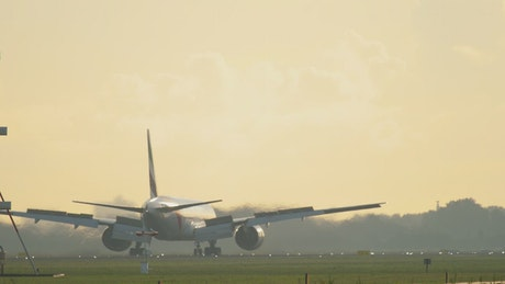 Cargo plane landing at the airport at dawn