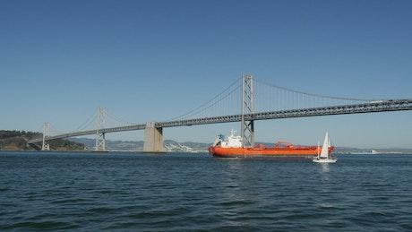 Cargo ship crossing the bridge