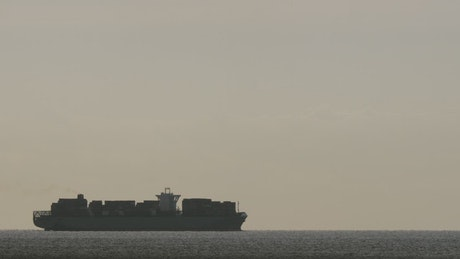 Cargo ship on the horizon