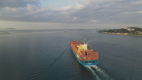 Cargo ship sailing in the sea