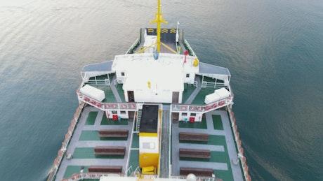 Cargo ship sailing near a shore