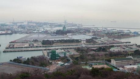 Cargo ship sailing through the industrial port