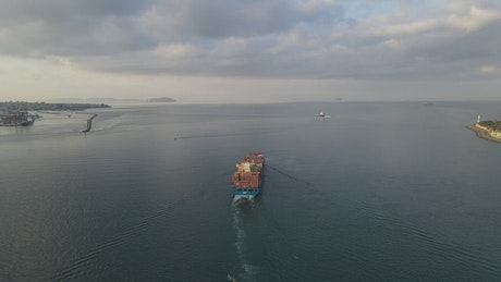 Cargo ship starting a trip from the port city