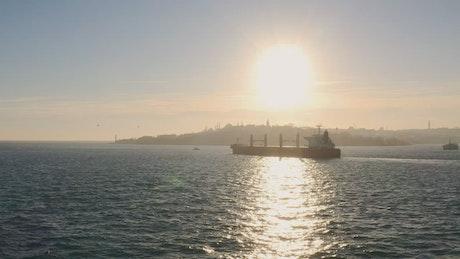 Cargo ship under the sun