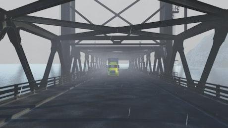 Cargo truck crossing a bridge while raining