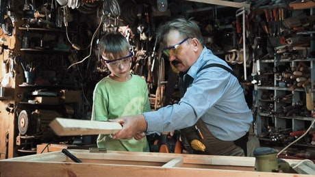 Carpenter and grandson in the workshop