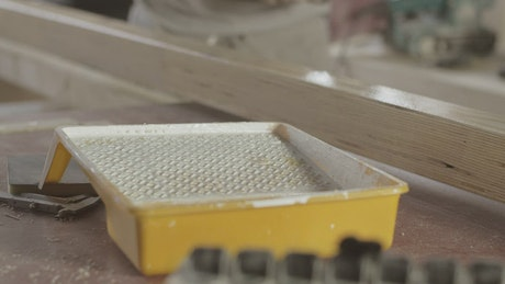 Carpenter applying varnish to wood