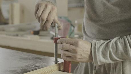 Carpenter clamping wood down