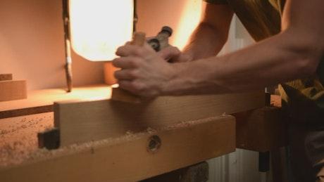 Carpenter lowering a table, static shot