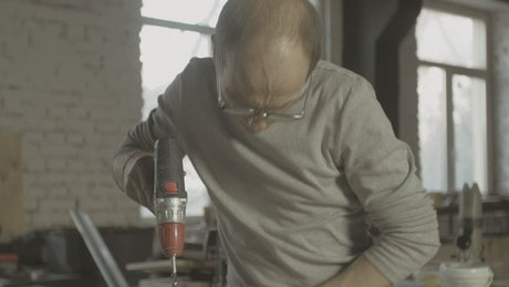 Carpenter using a drill
