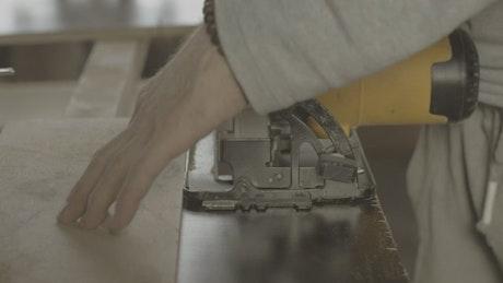 Carpenter using a wood cutter
