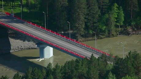 Cars crossing a bridge in the countryside