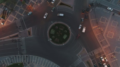Cars driving around an intersection