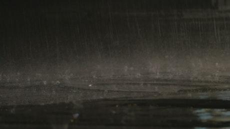 Cars driving as heavy rain falls
