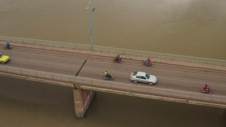 Cars driving over a bridge in Mali