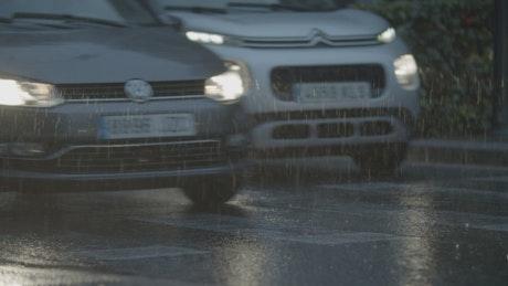 Cars driving through rainfall