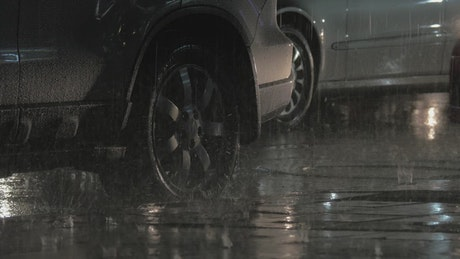 Cars parking in the rain