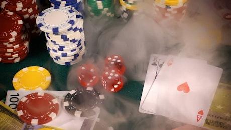 Casino chips falling in a poker board