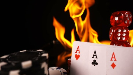 Casino games on fire with dice and cards