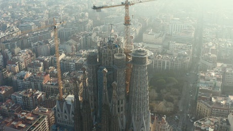 Cathedral under repair with cranes in Barcelona