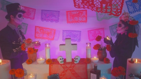 Catrin and Catrina at an altar on day of the dead