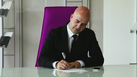 CEO signing a contract