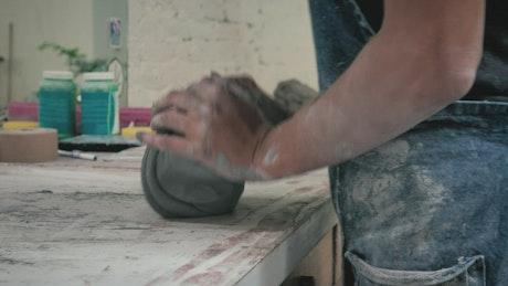 Ceramic artist working in the workshop