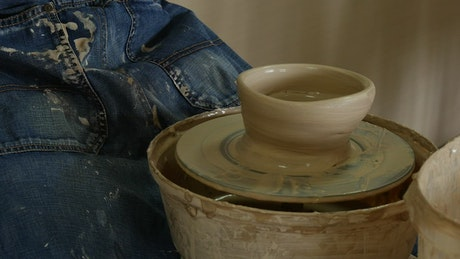 Ceramic artist working with raw clay