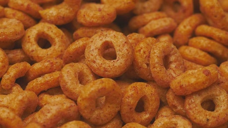 Cereal texture of oatmeal and cinnamon rings, rotating