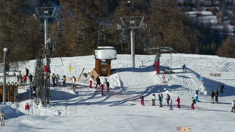Chairlift base and skiers