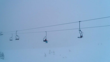 Chairlifts on a mountain covered with snow