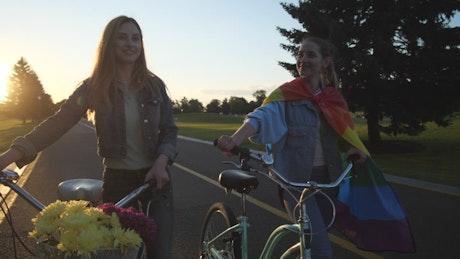 Chatting while pushing their bikes