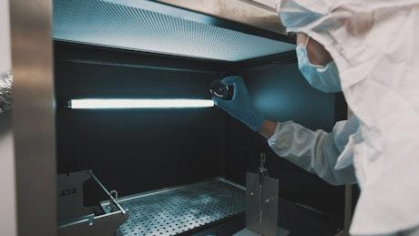 Checking a lens at a factory